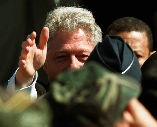 Former President Bill Clinton reaches out to shake hands with troops during his visit to Barksdale Air Force Base in 1999.