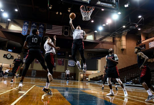Marquill Smith dunks the ball during a scrimmage on Wednesday, Nov. 6, at the Sanford Pentagon.