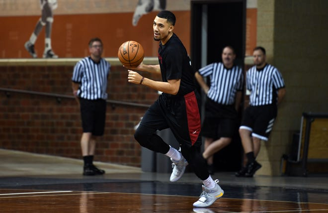 Skyler Flatten dribbles a ball around the court to warm up during Skyforce practice on Wednesday, Nov. 6, at the Sanford Pentagon.