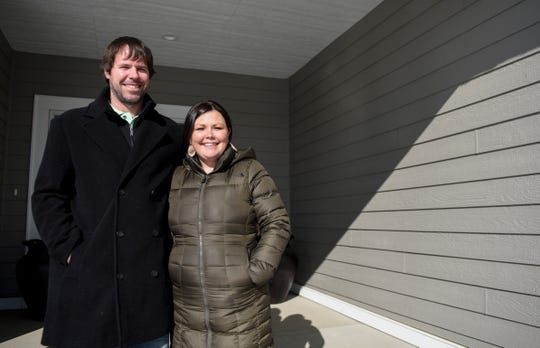 Anthony and Kristin Blaine stand on the steps of their recently built home on Thursday, Nov. 7, 2019 in Hartford, S.D. The Blaine's lived in Sioux Falls but said they decided to move to Hartford for the small town and community based feel.
