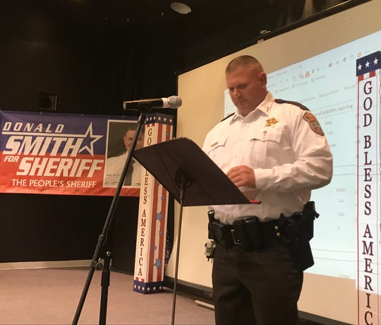 Augusta County Sheriff Donald Smith pauses before giving his victory speech Tuesday night to supporters at Saint Paul's United Methodist Church in Staunton.