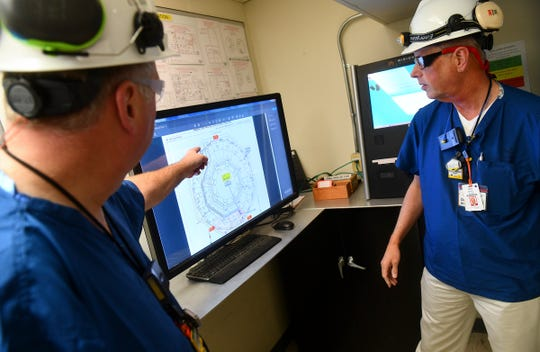 U.S. Nuclear Regulatory Commission resident inspectors Donald Krause, right, and Paul Zurawski point to information on a computer screen Wednesday, Nov. 6, 2019, at the Monticello Nuclear Generating Station.