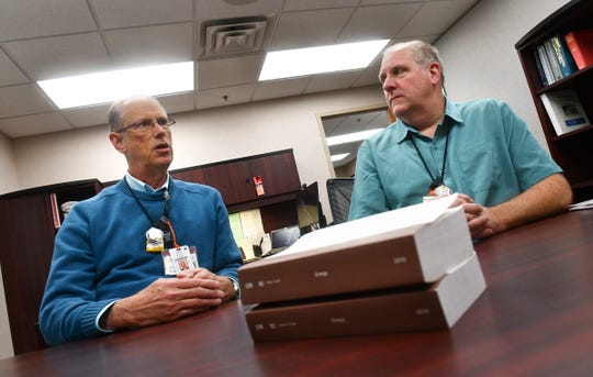 U.S. Nuclear Regulatory Commission resident inspectors Donald Krause and Paul Zurawski talk about their work behind copies of the federal regulations Wednesday, Nov. 6, 2019, at the Monticello Nuclear Generating Station.