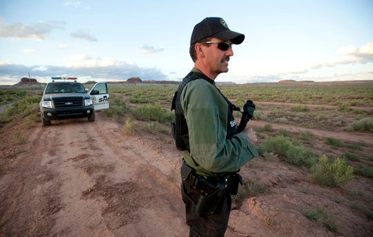A lieutenant from the Mohave County Sheriff's Department stands watch  Saturday in the area where Scott Curley was last seen east of Fredonia.