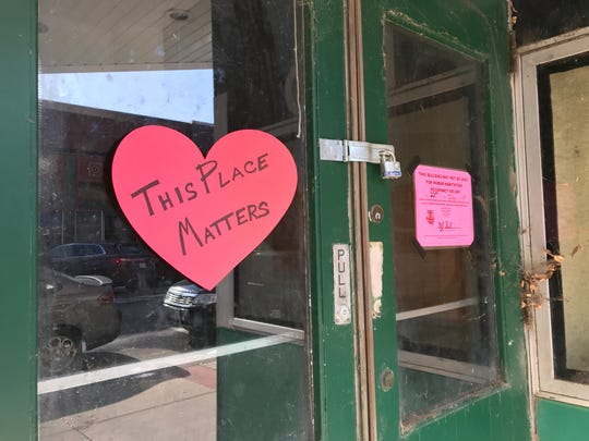 "A note says ""This Place Matters"" on the door of the Fox Theater building on Main Street in Stevens Point."