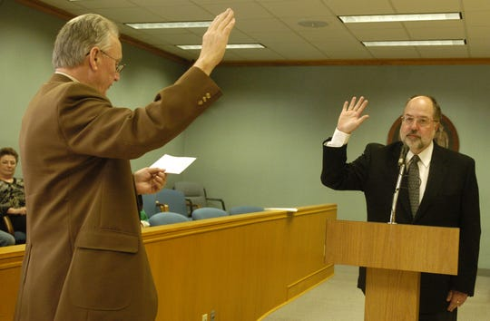 Former Portage County Clerk Roger Wrycza (left) administers the oath of office to Mark Maslowski as he becomes the first county executive in April of 2006. When Maslowski ran for office the first time he didn't have a Web site. Times are different this time around, he said.