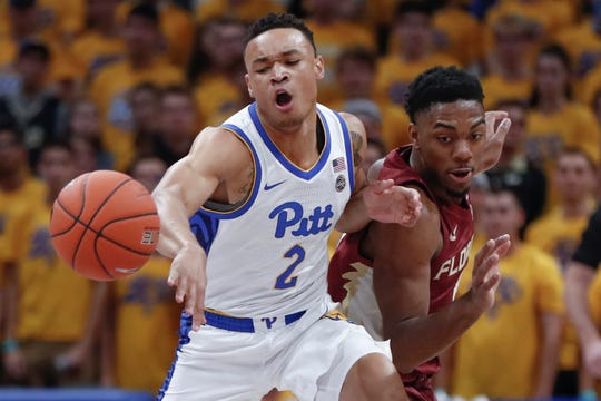 Pittsburgh's Trey McGowens (2) and Florida State's Anthony Polite, right, chase the ball during the first half of an NCAA college basketball game Wednesday, Nov. 6, 2019, in Pittsburgh. (AP Photo/Keith Srakocic)