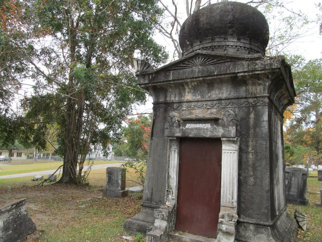 Calvin Phillips designed and built the mausoleum in which he's buried in Oakland Cemetery.