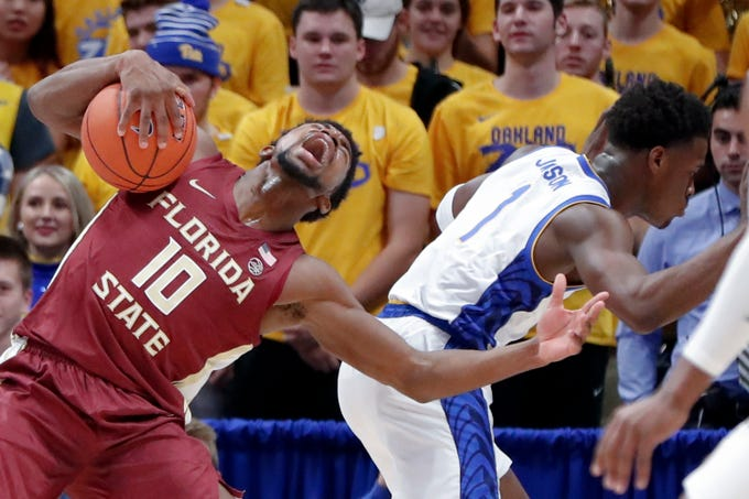 Florida State's Malik Osborne (10) grabs a rebound next to Pittsburgh's Xavier Johnson (1) during the first half of an NCAA college basketball game Wednesday, Nov. 6, 2019, in Pittsburgh. (AP Photo/Keith Srakocic)