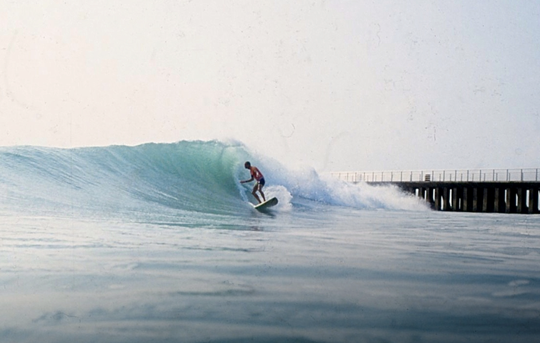 Allen Margolis surfs an empty Sebastian Inlet in the mid-1990s. Margolis was a renowned surfer and surf photographer known for his kindness.