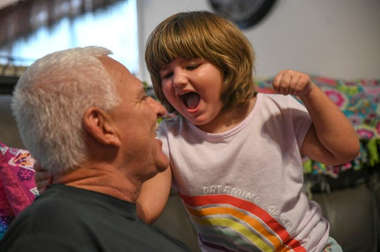 Darin Jones, and his adopted daughter Maci, 4, play together inside the living and play room of their home on Wednesday, Nov. 6, 2019, in Indian River County. Darin Jones, a retired member of the Indian River County Sheriff's Office, and his wife Lisa, took in Maci who suffered from severe and nearly fatal head injuries, allegedly at the hand of her mother's boyfriend on Sept. 20, 2017, when she was 2½ years old.