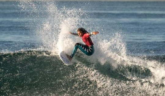 Palm City's Zoe Benedetto, 14, competes at the ISA World Junior Surfing Championship in Huntington Beach,. Calif.