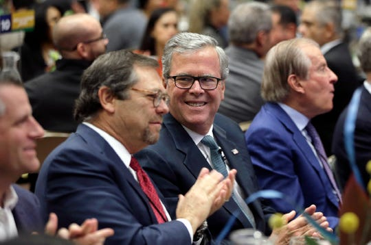 Jeb Bush talks with El Paso businessman Paul Foster before speaking at the U.S.-Mexico Border Summit Thursday.