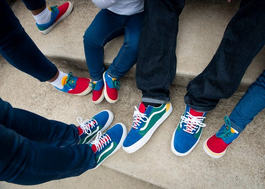 All the family members wore matching, colorful shoes.