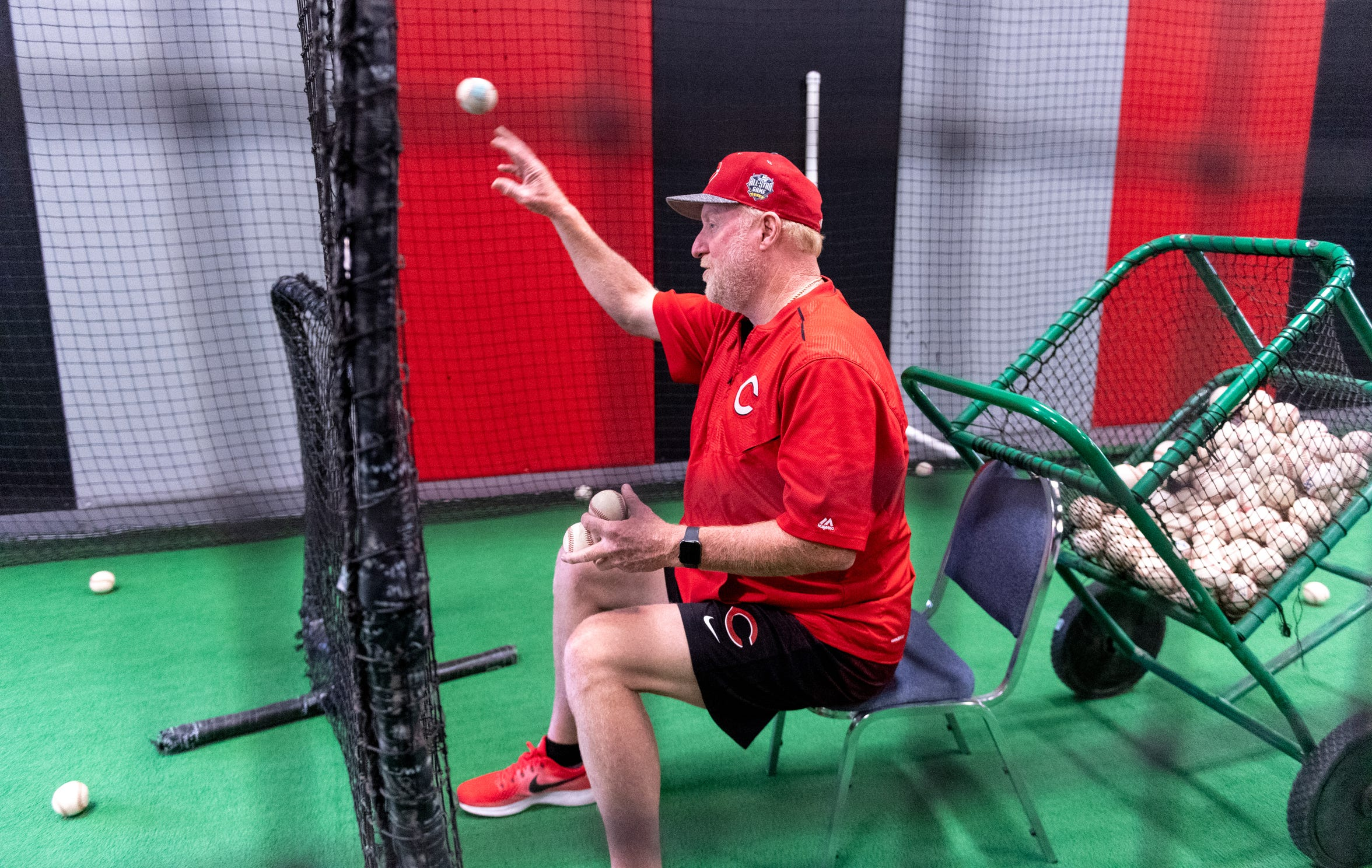 Former Cincinnati Reds pitcher Ron Robinson works with local young people on baseball skills at The Dugout in Visalia on Tuesday, October 29, 2019.