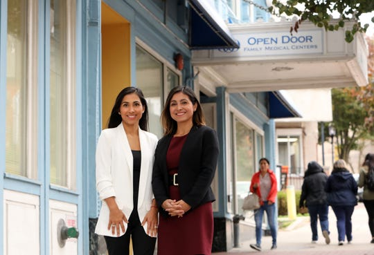 Andrea Ruggiero, 37, right, vice president of community health at Open Door Family Medical Center and her sister, Grace Battaglia, 34, the director of marketing at Open Door outside the center in Ossining Nov. 5, 2019.  In the early 90s, the sisters arrived as young kids with their parents from Ecuador and were first introduced to Open Door in Ossining for their checkups and sick visits.