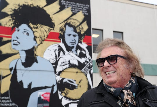 Singer and former New Rochelle resident Don McLean admires the mural done of him and Alicia Keys on the outside of a building at the corner of North Avenue and Bonnefoy Place in New Rochelle Nov. 7, 2019. McLean was in town to perform at a private party and decided to check out the mural.