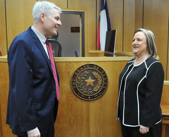 Wichita County District Attorney John Gillespie, left, congratulates Meredith Kennedy, newly appointed to be 78th District Court judge, Thursday morning.