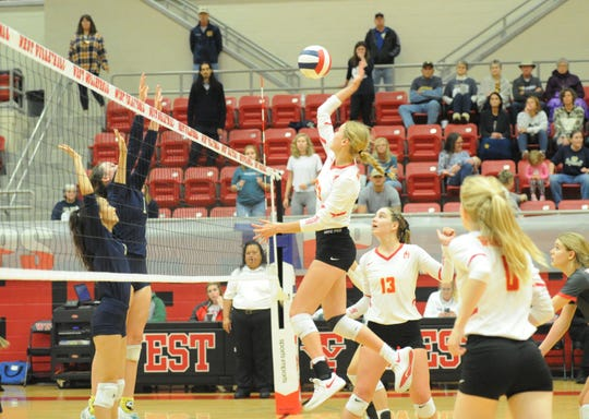Christ Academy sophomore Sydney Rouillard soars for a spike with Notre Dame's Reagan Macha and Leilani Nguyen defending in a TAPPS Class A state semifinals match Thursday, Nov. 7, in West.