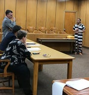Jordan Adawalla, right, who is accused of sexually assaulting a child, complains about his defense attorney, Christopher Jones, standing left, in 89th District Court Thursday. Judge Charles Barnard agreed to allow Jones, who cited issues with Adawalla's behavior, to withdraw from the case.