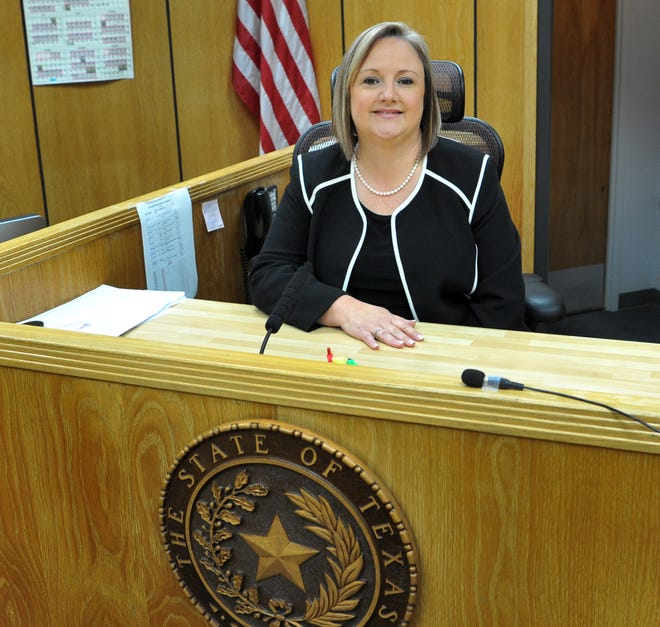 Meredith Kennedy of Wichita Falls tries out her new seat Thursday morning after Gov. Greg Abbott announced her appointment to be 78th District Court judge.