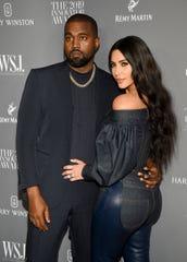 Kanye West, left, and Kim Kardashian West