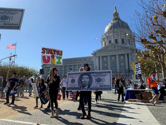 Marchers at a recent rally organized by Democratic presidential hopeful Andrew Yang parade around Civic Center Plaza in front of San Francisco's City Hall.