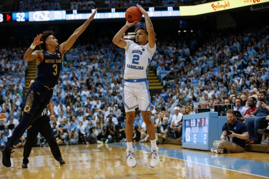 North Carolina guard Cole Anthony (2) shoots a three-pointer over Notre Dame guard Prentiss Hubb in the second half at the Dean E. Smith Center.