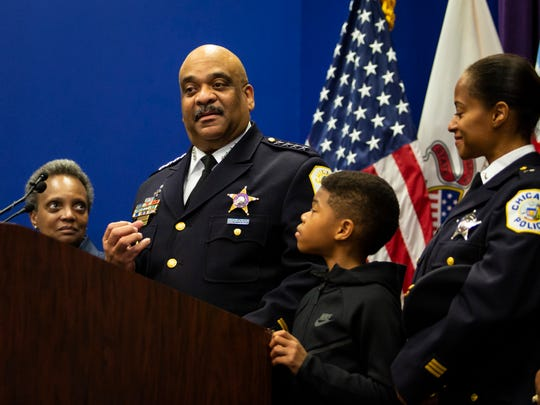 Chicago Police Department Supt. Eddie Johnson, with his 10-year-old son, his wife right, and and Mayor Lori Lightfoot, left, looking on, announces his retirement during a press conference at CPD headquarters, in Chicago, Thursday morning, Nov. 7, 2019.