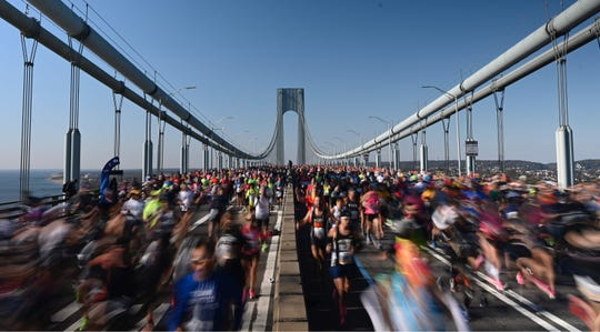 Runners cross the Verrazano Narrow Bridge during the TCS New York City Marathon in New York on Nov. 3, 2019.