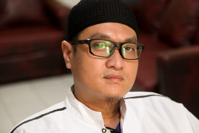"Abu Albani, who uses the honorific ""Ustad"" meaning ""teacher"" or ""master,"" runs a clinic in east Jakarta where he offers a number of health-related and spiritual services including Islamic exorcisms known as ruqyah, here on Aug. 13, 2019. Many of his clients who request a ruqyah are seeking to be cured of their homosexuality, he says."
