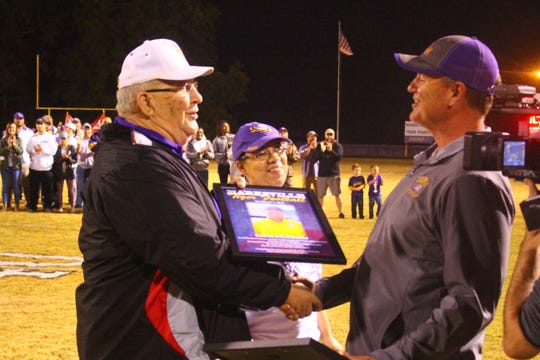 Marksville coach J.T. Dunbar (right) was honored as the Tigers' winningest coach prior to the game Thursday at Warren Douglas Stadium.