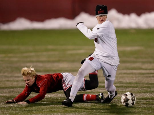Seymour High School's Teig Driessen (9) gains control of the ball against Shorewood High School's Owen Weisse (3) during their WIAA Division 3 semifinal boys state soccer game Thursday, November 7, 2019, at Uihlein Soccer Park in Milwaukee, Wis. Shorewood won 2-1.