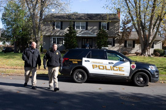 Police swarm a home at Kings Mountain Road, the residence of a friend of a missing Freehold Township woman on Friday. Authorities said   the search is unrleated to the woman'sr disappearance.