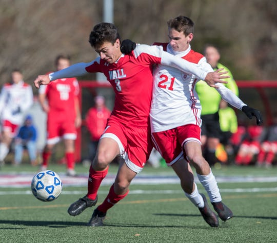 Wall Thomas Perry battles for the ball with Ocean's Michael Delia.  Ocean Boys Soccer vs Wall in NJSIAA Central Jersey Group III final in Wall NJ on November 8, 2019.