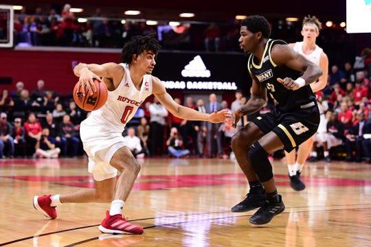 Geo Baker handles for Rutgers against Bryant.