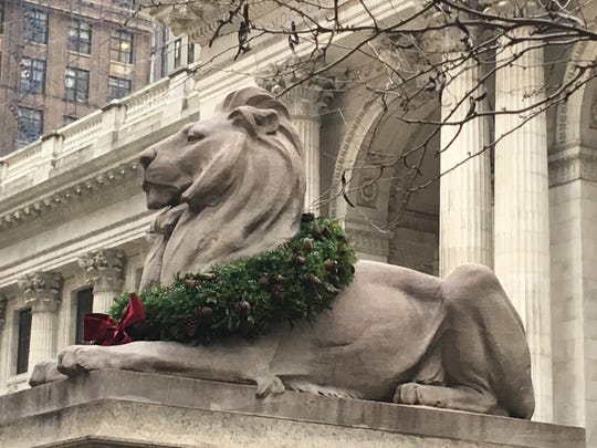 Patience and Fortitude, the lions in front of the New York Public Library, wear wreaths for the holiday season.