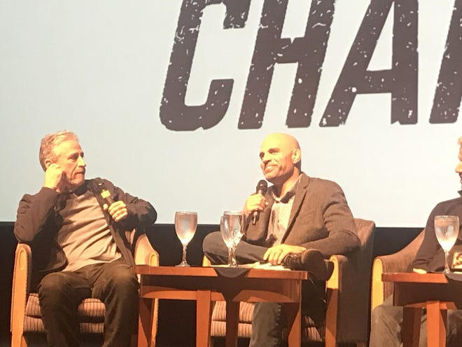 """Jon Stewart and James Wilks during a  panel discussion on the movie """"The Game Changers"""" Thursday, Nov. 7 at the Pollak Theatre  on the campus of Monmouth University in West Long Branch."""