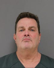 Booking photo of Douglas Thompson, 55, of Jackson.