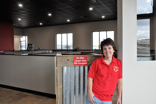 Tammy Reese, owner of The Flipping Egg that opened in 2012, stands at the foyer of the dining area at the new location at 4138 Ridgemont Dr., which began service on Friday.
