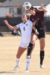 McMurry's Meriah Sikora (3) gets her head on the ball over Hardin-Simmons' Taylor Bernal (8) during the ASC tournament semifinal at the HSU Soccer Complex on Friday, Nov. 8, 2019. The Cowgirls won 2-1 to advance to Sunday's final.