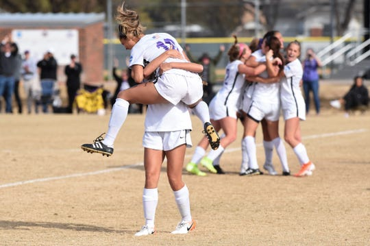 Hardin-Simmons forward Randie Dennison (10) jumps into Mackensie Moreno's arms after assisting on the tying goal of the ASC tournament semifinal at the HSU Soccer Complex on Friday, Nov. 8, 2019. The Cowgirls won 2-1 to advance to Sunday's final.