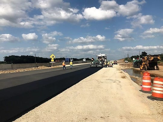New asphalt is laid along a section of Ranger Hill in June 2019.