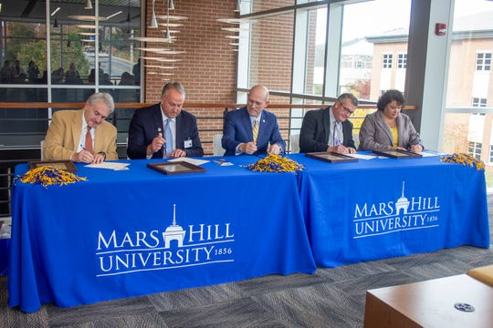 Mars Hill University President Tony Floyd, center, is flanked by superintendents from four WNC school districts (Tony Baldwin of Buncombe County, Will Hoffman of Madison County, Chad Calhoun of Mitchell County and Kathy Amos of Yancey County) for a ceremony formally introducing the Local Lion Promise scholarship.