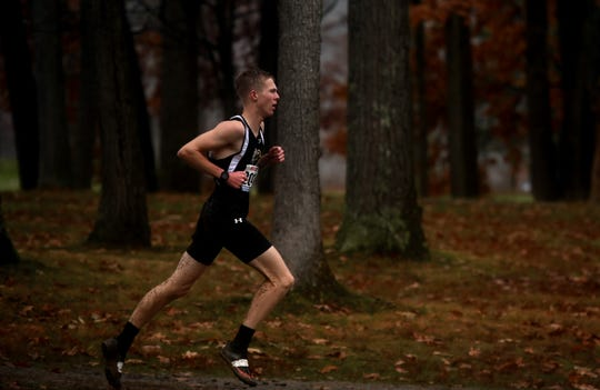 As has been case most of his senior season, Windsor's Josh Stone runs alone en route to winning the Section 4 Class B title Nov. 7 at Chenango Valley State Park.