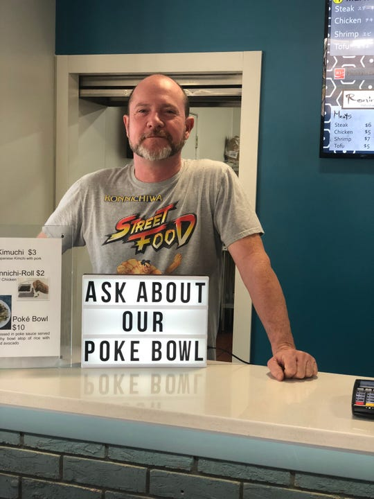As the sign reads, Konnichiwa head chef Keith Carter suggests the Black Mountain restaurant's poke bowl, which features fresh Ahi tuna.