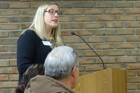 Erin Stine of the Crawford Partnership presents a proposal for adding an electric vehicle charging station to a city parking lot during a Bucyrus City Council committee meeting Thursday.