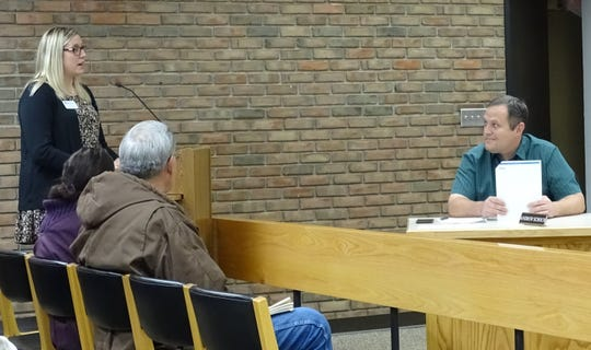 Bucyrus City Council member Andy Schoch, right, listens as Erin Stine of the Crawford Partnership presents a proposal for adding an electric vehicle charging station to a city parking lot during a committee meeting Thursday.