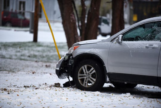 One of two cars were sidelined along Pine Street with dented front end. Snow made the morning commute slippery on Friday, Nov. 8, 2019.