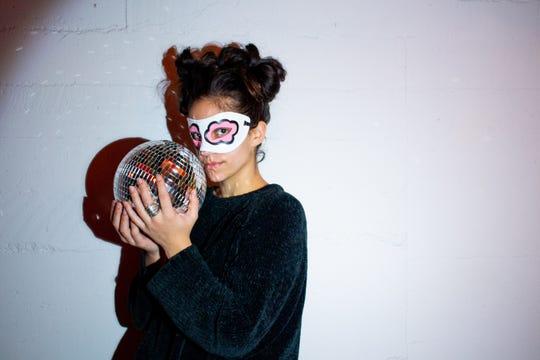 Sabrina Comellas leads a masquerade ball fundraiser for Girls Rock Vermont on Nov. 23 in Burlington.